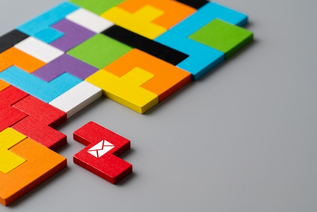 Contact us icon on colorful puzzle