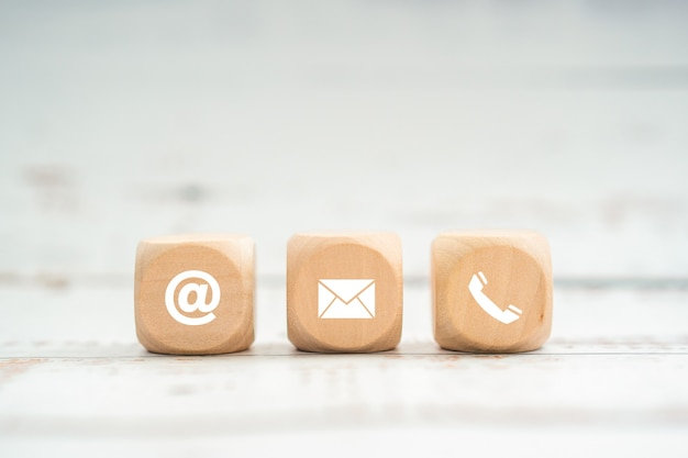Contact us icon (phone, email, mail ) on wood cube, customer support service