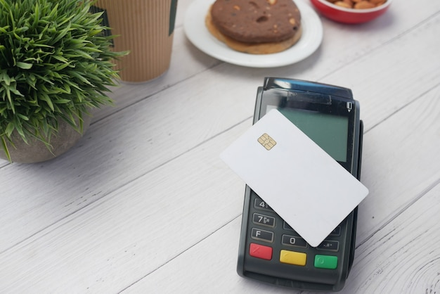 Contactless payment concept credit card on a pos machine