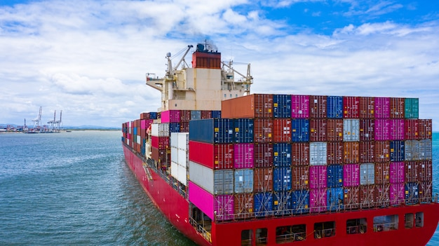 Container cargo ship carrying container for business freight import and export.