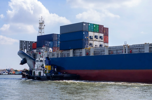 Container cargo ship with tugboat