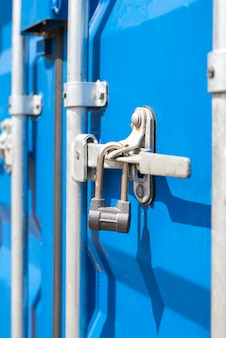 Container close-up. blue cargo container with a lock. the concept of the increased cost of freight. banner with place for text.