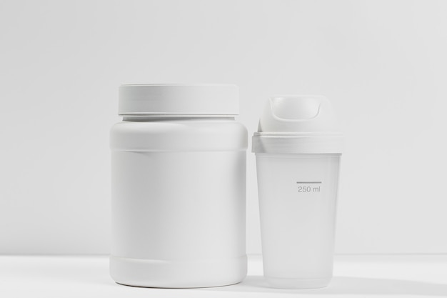 Container on desk with gym supplements