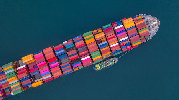 Container ship carrying container aerial view, business import and export logistic and transportation.