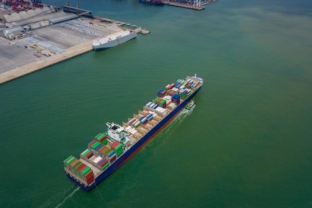 Container ship in export and import business and logistics. shipping cargo to by the sea. water transport international. concept aerial top view from drone