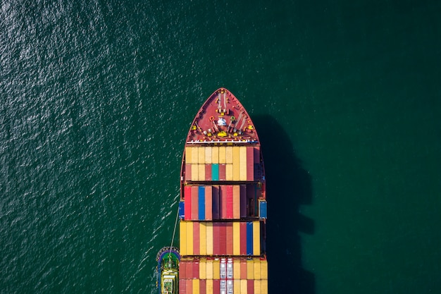 Container ship import and export business and logistics shipping cargo open sea transportation international aerial view