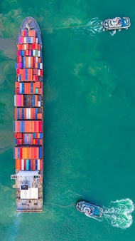 Container ship working at industrial port, business import and export logistic and transportation of international