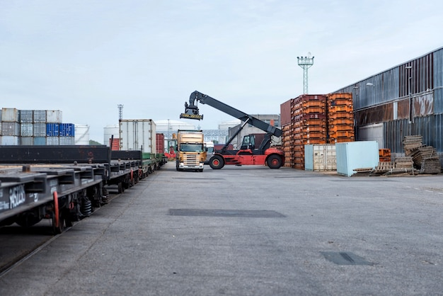 Container stacker unloads trucks.
