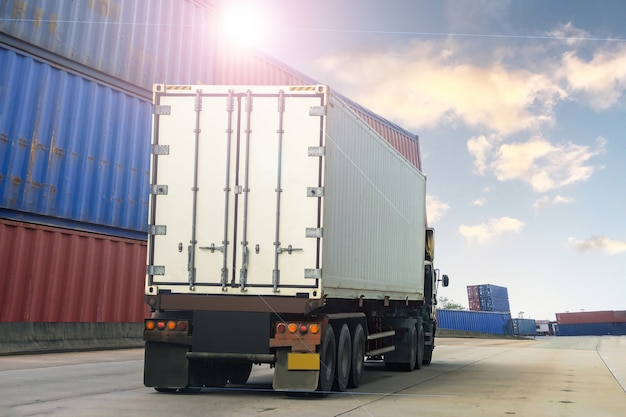 Container white truck in ship port logistics.transportation industry in port business concept.import,export logistic industrial transporting land transport freight warehouse storge