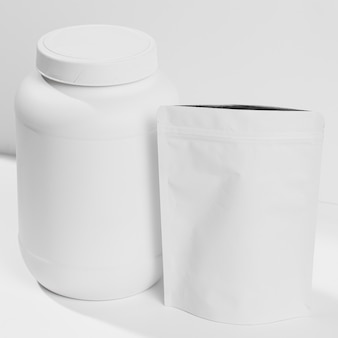 Container with gym powder supplements on desk