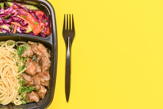 Container with healthy food on color