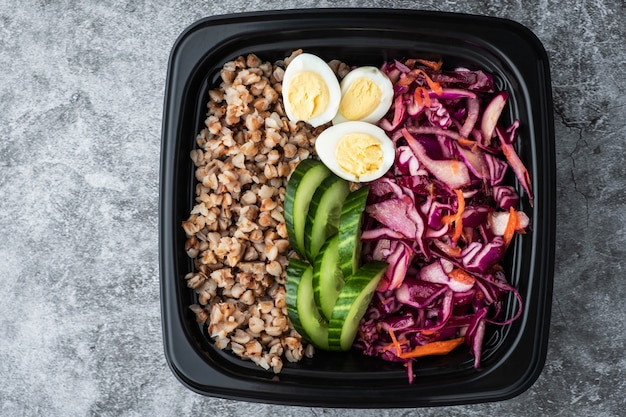 Container with natural healthy vegetarian lunch, food delivery
