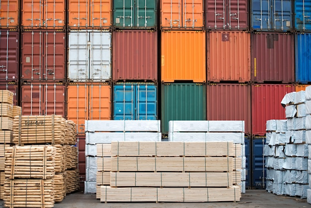 Containers and neatly stacked timber stock.