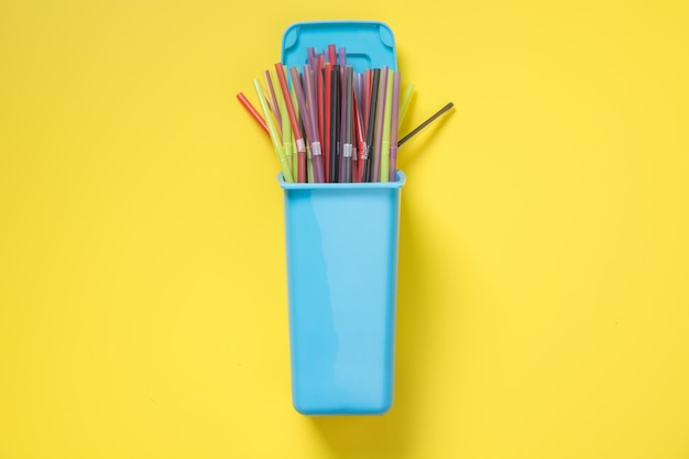 Containers for separate collection garbage with plastic straw. top view. save planet.