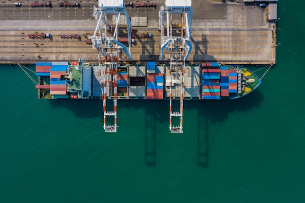 Containers ship loading and unloading import export business and industry services international aerial view