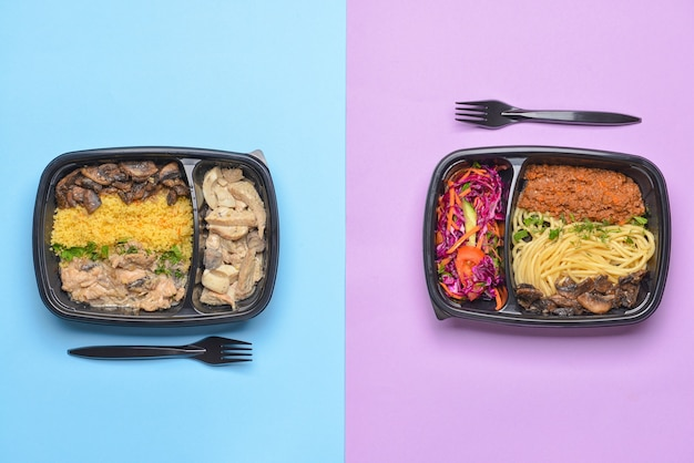 Containers with healthy food on color