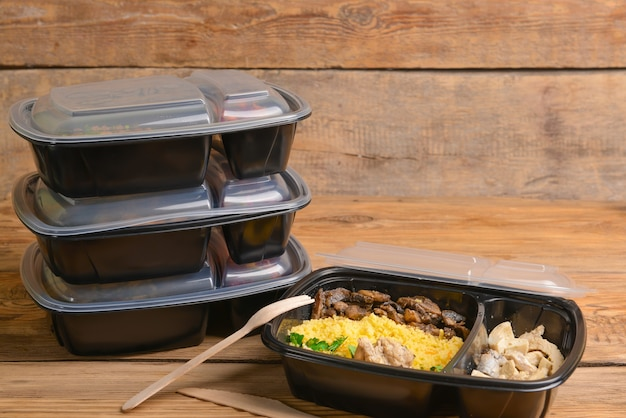 Containers with healthy food on wooden