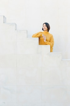 Contemplated woman standing on staircase