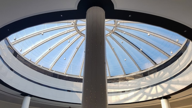 Contemporary art of glass and metal, roof background. look at the glass dome. geometric detail.