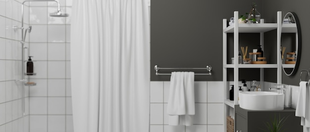 흰색 타일이 있는 원형 거울 회색 벽과 샤워 구역 선반이 있는 현대적인 욕실 인테리어
