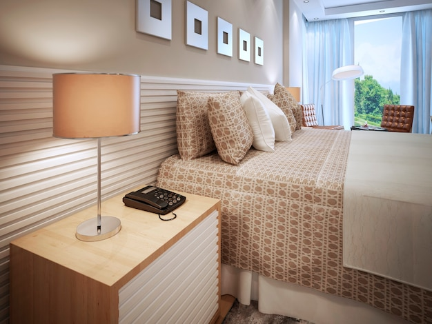 Contemporary bedroom design and bed with cushions and table lamp with brown shade.