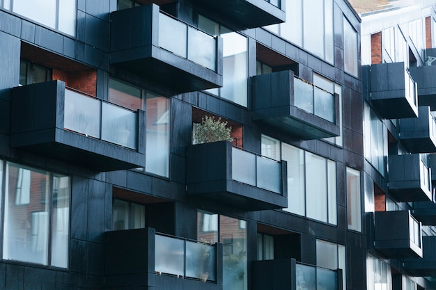 Contemporary black building exterior wit balconies