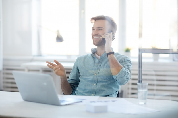 Contemporary businessman speaking by phone