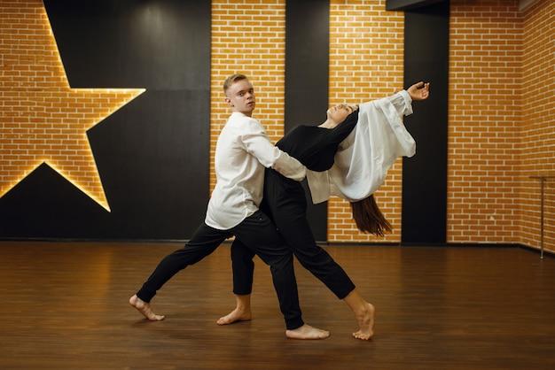 Contemporary dance couple training in studio
