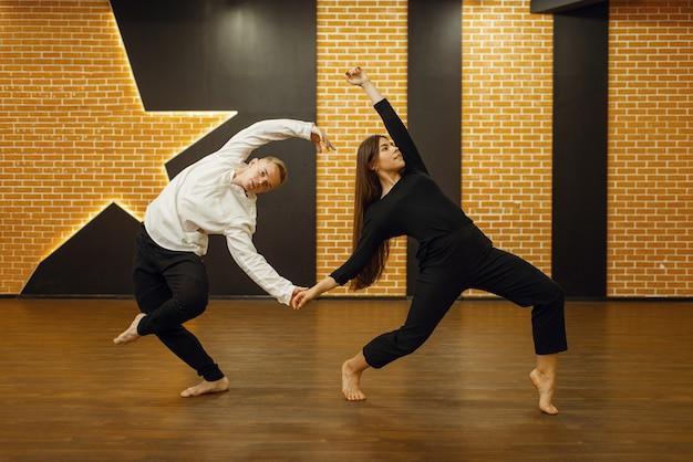 Contemporary dance partners, couple posing in studio.