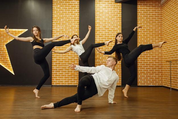 Contemporary dance performers posing in studio