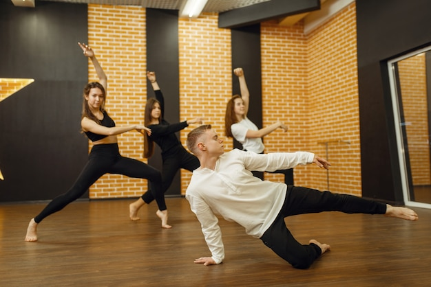 Contemporary dance performers posing in studio.
