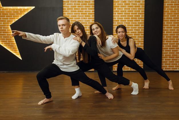 Contemporary dance performers in studio, snapshot in action.