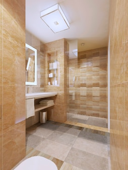 Contemporary design of bathroom with tiled walls and flooring with glass doors to shower.