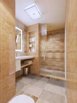 Современный дизайн ванной комнаты с кафельными стенами и полом со стеклянными дверями для душа.