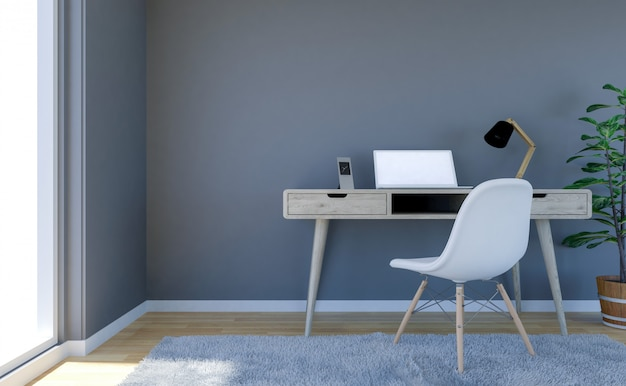 Contemporary living room interior with grey wall and working desk with laptop computer