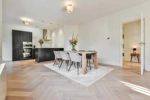 Contemporary minimalist style interior design of modern apartment with cozy dining zone and open kitchen