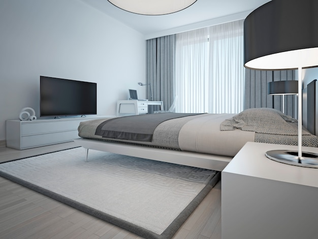 Contemporary monochrome hotel room with laid elegant bed and furniture light gray color and elegant chrome lamps with black shades.