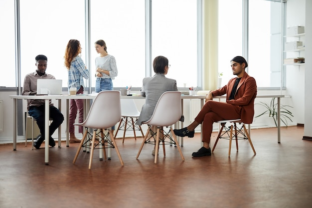 Contemporary people working in office Premium Photo