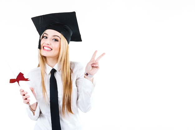 Content alumnus gesturing at camera with diploma