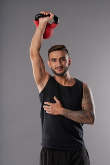 Content athlete training with kettlebell