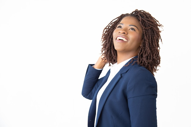 Content businesswoman laughing and looking up