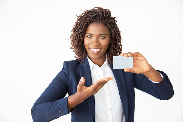 Content businesswoman showing card