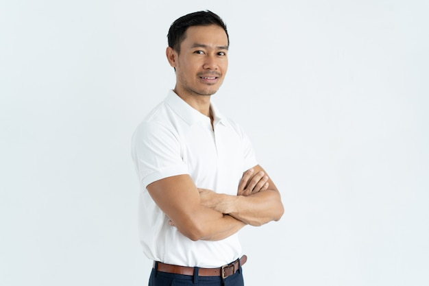 Content confident handsome asian businessman looking at camera