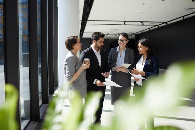 Content enterprising colleagues discussing ideas