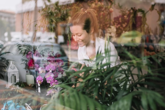 Content girl working with flowers in shop