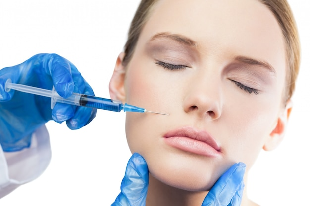 Content gorgeous model having botox injection above the lips