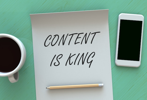 Content is king, message on paper, smart phone and coffee on table