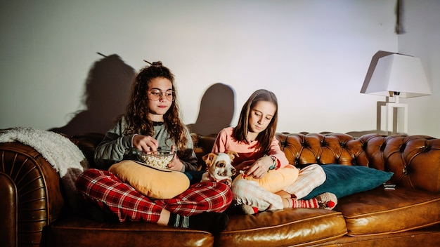Content kids with dog watching tv
