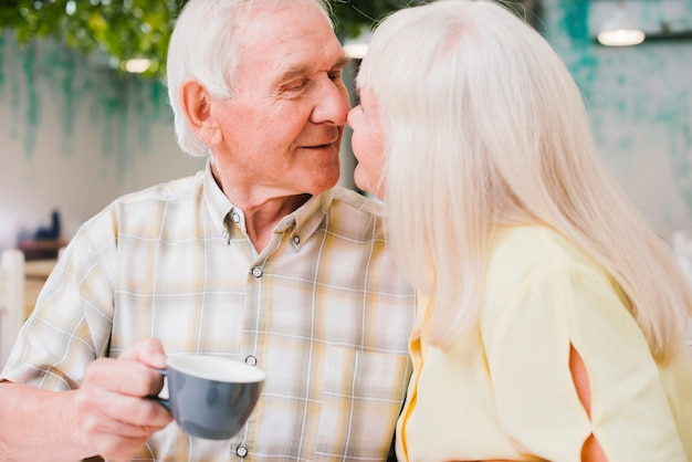 Content loving couple with tea in cafe