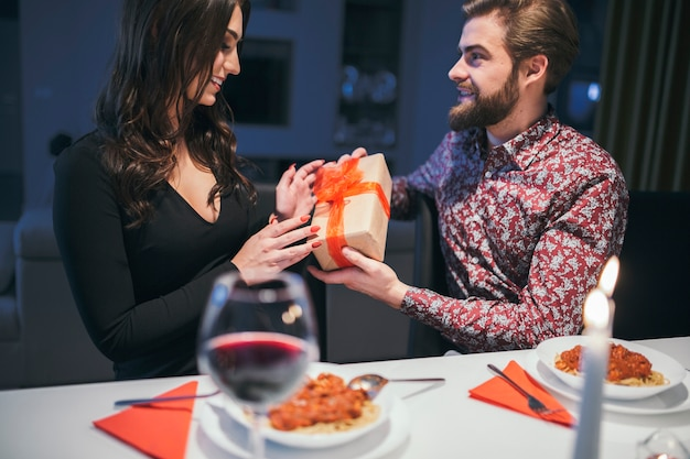 Content man giving present to woman
